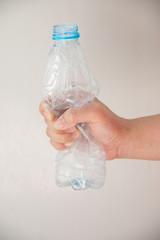 Hand squash a plastic bottle