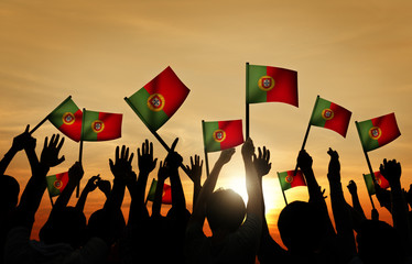 Group of People Waving Portuguese Flags Back Lit