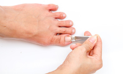 woman cutting toenail.