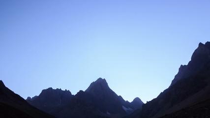 Moon illuminates the valley. Time Lapse. Pamir