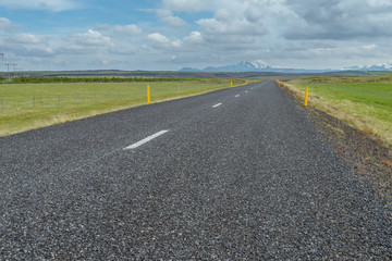 Typical road in Iceland with Hekla Vulcano on the horizon.