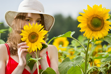 Young girl in sunflowers