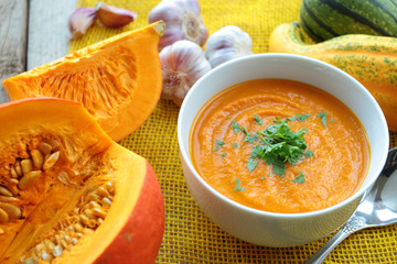 Pumpkin soup with fresh herbs and pumpkins