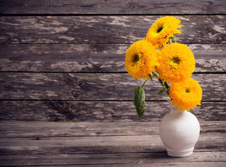 Still life with sunflowers on wooden background