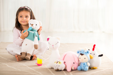 Girl with knitted toys