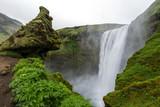 Skogafoss waterfall among green cliffs, South Iceland poster