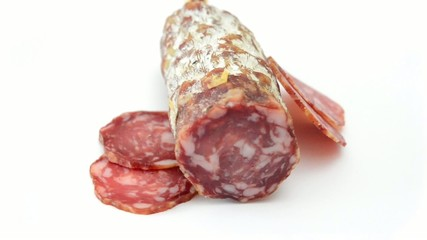 traditional salami sliced rotating on white background