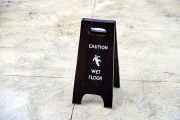 Sign warning of caution wet floor on floor