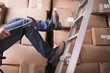 Worker falling off ladder in warehouse - 71255049