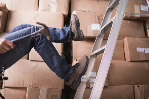 Worker falling off ladder in warehouse - 71255049