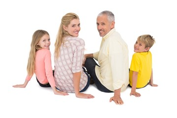 Happy family sitting and smiling