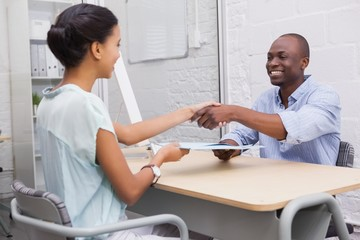 Happy business people shaking hands