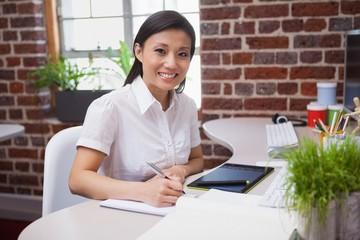 Casual designer working at her desk