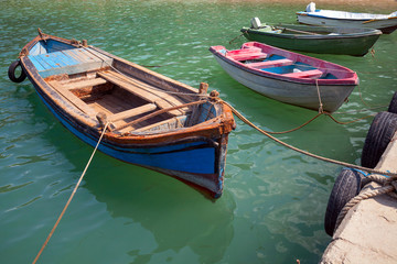 Old small wooden fishing boats moored in small Bulgarian town