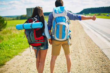 Hitchhiking couple