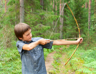 Kid with homemade bow and arrow