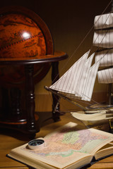 model sailing ship, globe and compass