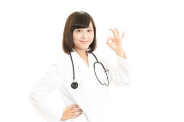 ガッツポーズの女医