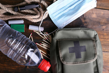 Emergency preparation equipment on wooden background