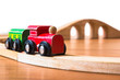 Toy train made of wood with bridge in backdrop - 71261640