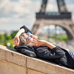 Young woman talking with mobile phone in front of the Eiffel Tow