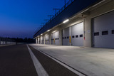Garages in race circuit. Night time.