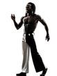 black man walking smiling  silhouette