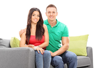 Attractive young couple posing on a sofa