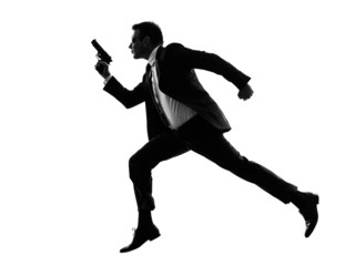 man with handgun running silhouette