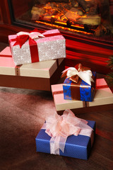 Christmas gifts near fireplace