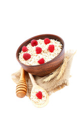 Fresh raspberry and Oatmeal flakes on white background. Healthy