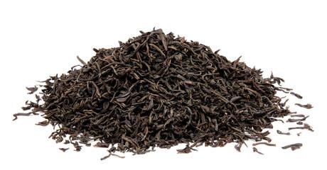 Dry black tea leaves isolated