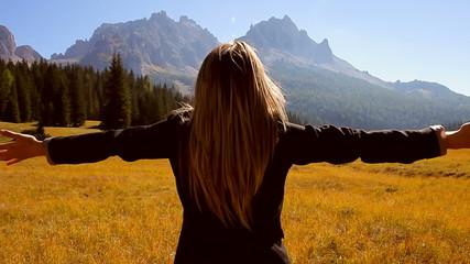 Woman enjoying fresh air in the mountain