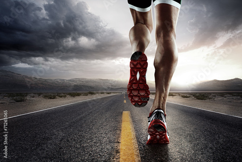 Poster Sports background. Runner feet running on road closeup on shoe.