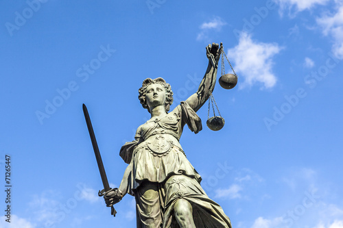Justitia (Lady Justice) sculpture on the Roemerberg square in Fr