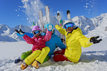 Skiing, winter, snow, family enjoying winter vacation
