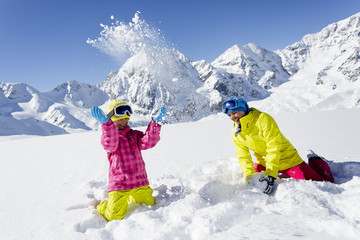 Ski, skier, sun and winter fun - skiers enjoying winter