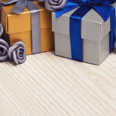 grey flowers and two gift boxes