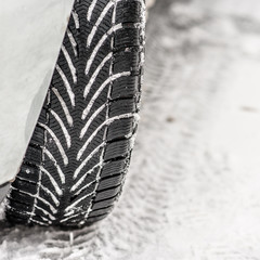 Winter tyre on snowy road