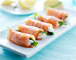 smoked salmon and arugul warp with cream cheese on platter - 71267068