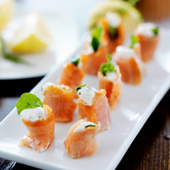appetizer platter with smoked salmon, cream cheese, and arugula