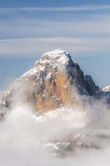 Dolomite Mountains covered with clouds in winter