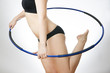 Young woman doing exercises with hoop