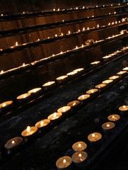wax candles lit in the Church during mass