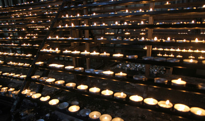 flames of wax candles during the Eucharistic Celebration in the