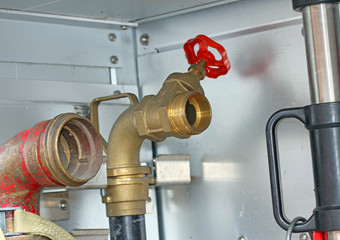 Sleeve valves of trucks of firefighters during a fire drill