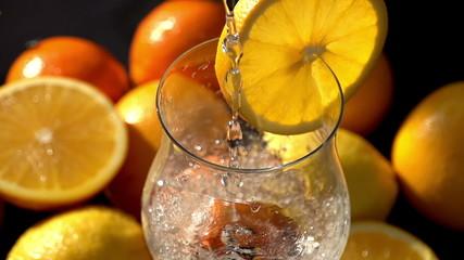 Drop Ice Cubes in Juice Closeup