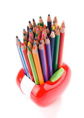 Colorful pencils in apple shaped stand