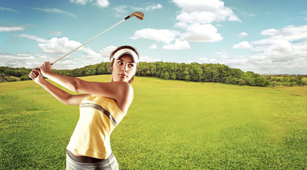 Young attractive female playing golf on the nature