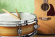Snare drum and acoustic guitar on a green background - 71271050
